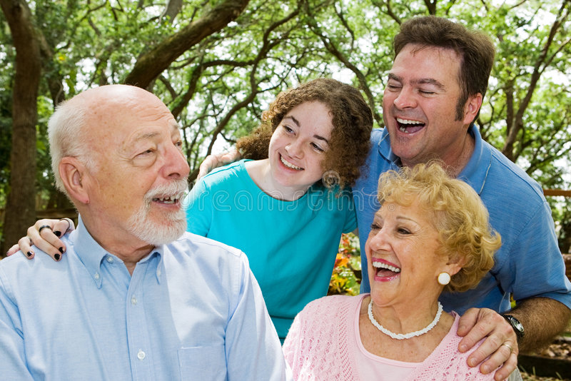 Grandpa Tells a Joke. Family in the park, laughing at a joke told by the grandfather