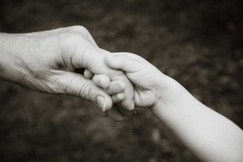 Grandparent And Grandchild Holding Hands Stock Photo