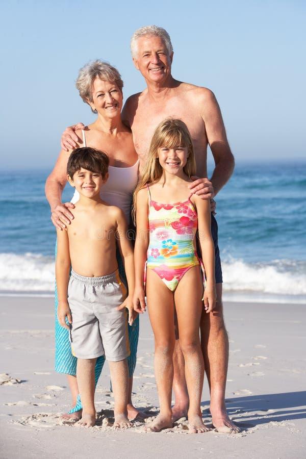 Free Grandparents And Grandchildren Standing On Beac Stock Image - 14688811