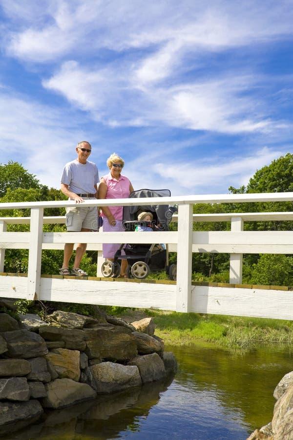 Grandparents on a bridge royalty free stock photo