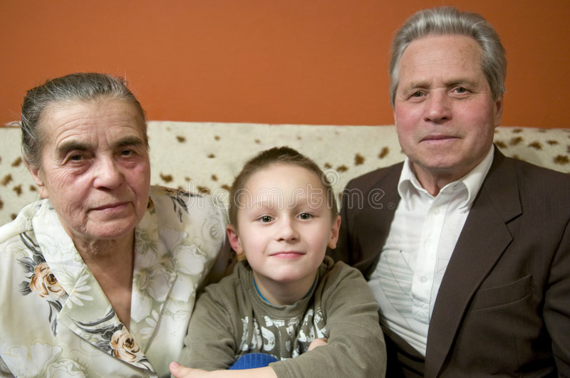 Grandparents com neto imagem de stock royalty free
