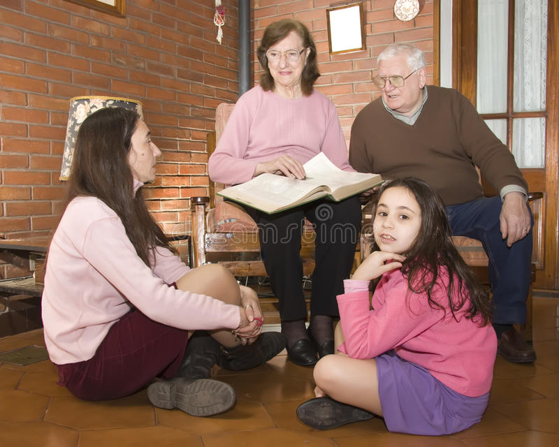 Grandparents, daughter and granddaughter stock photos