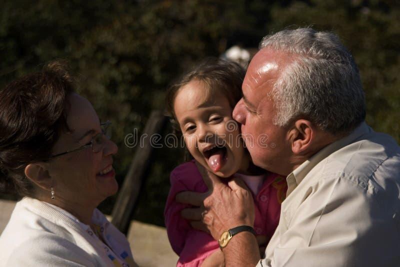 Grandparents e neta fotografia de stock