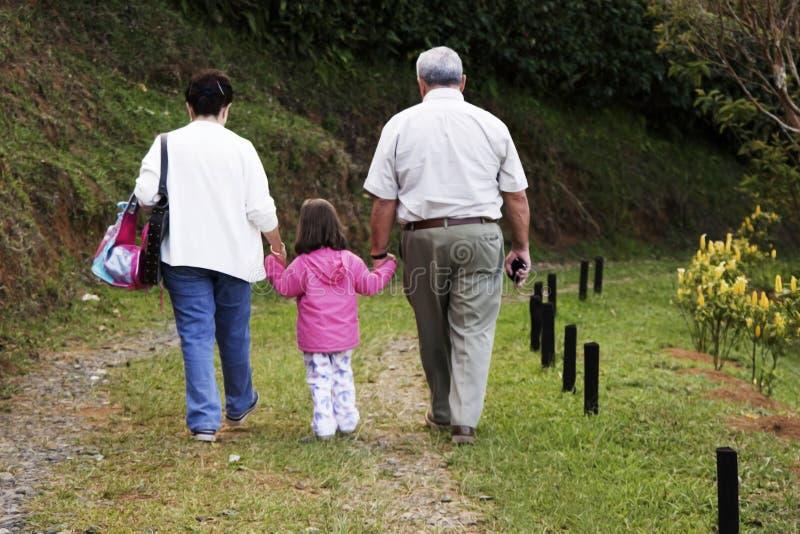 Grandparents e neta imagem de stock