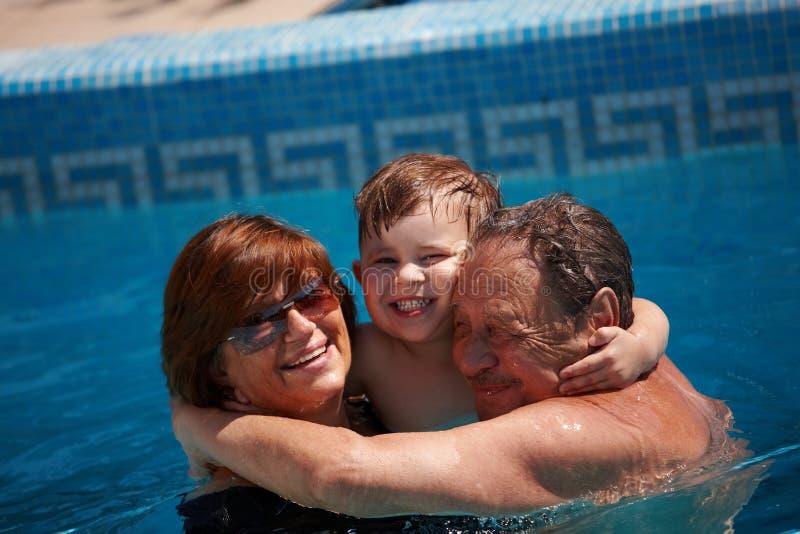 Grandparents e neto foto de stock