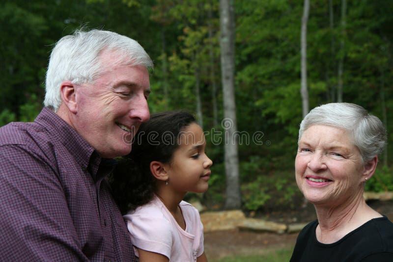 Grandparents With Grandaughter Stock Photo