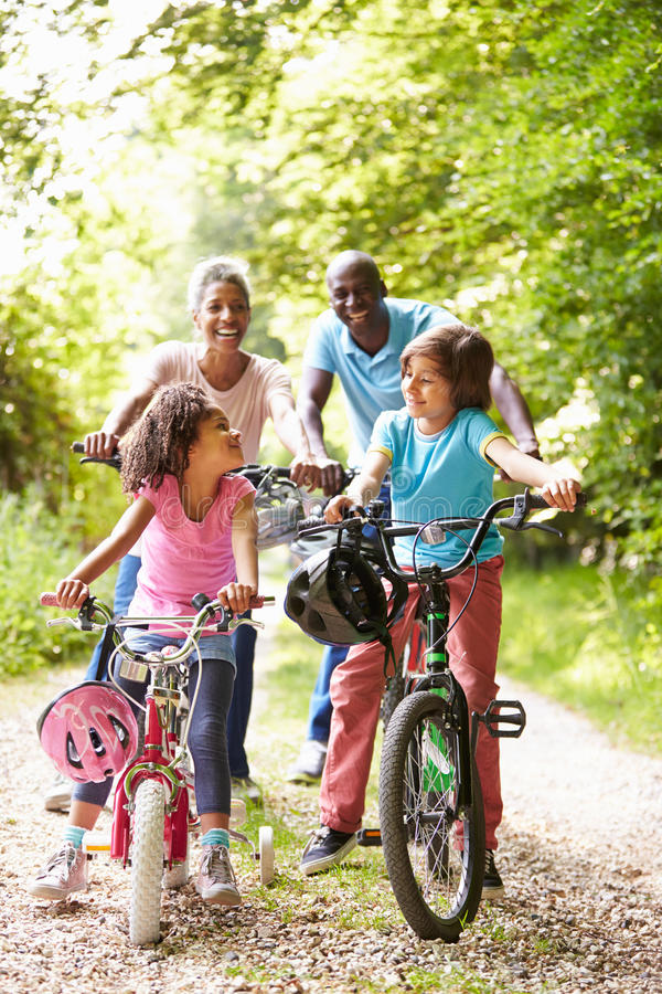Grandparents With Grandchildren On Cycle Ride In Countryside stock photography