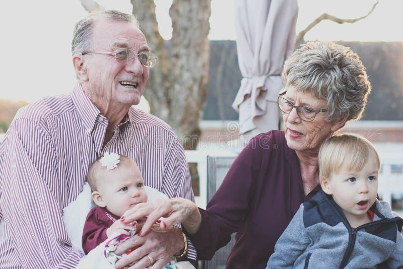 Grandparents with grandchildren outdoor stock image