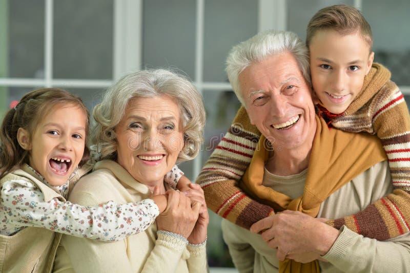 Grandparents with grandchildren portrait stock photos