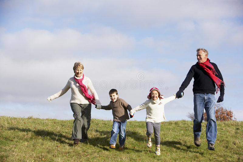 Grandparents And Grandchildren Running stock image