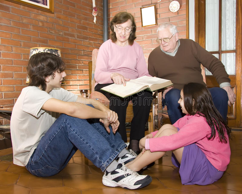 Grandparents and grandchildrens stock photography