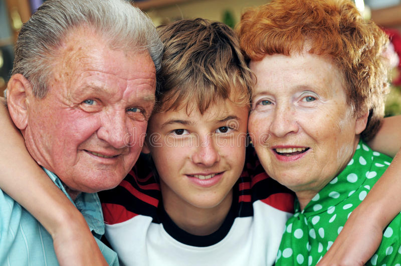 Grandparents with grandson. Embracing together portrait stock photo