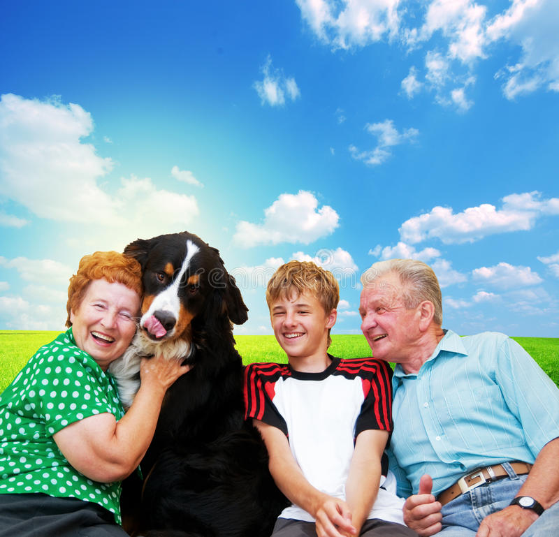 Grandparents, grandson and dog. Grandparents with grandson and dog family portrait stock images