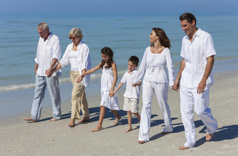 Grandparents, Mother, Father Children Family Walking Beach stock photos