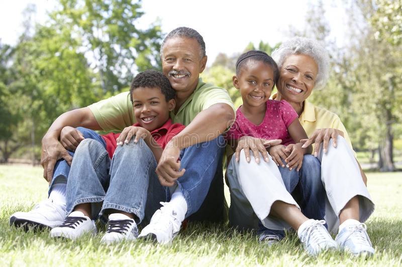 Grandparents In Park With Grandchildren stock photo