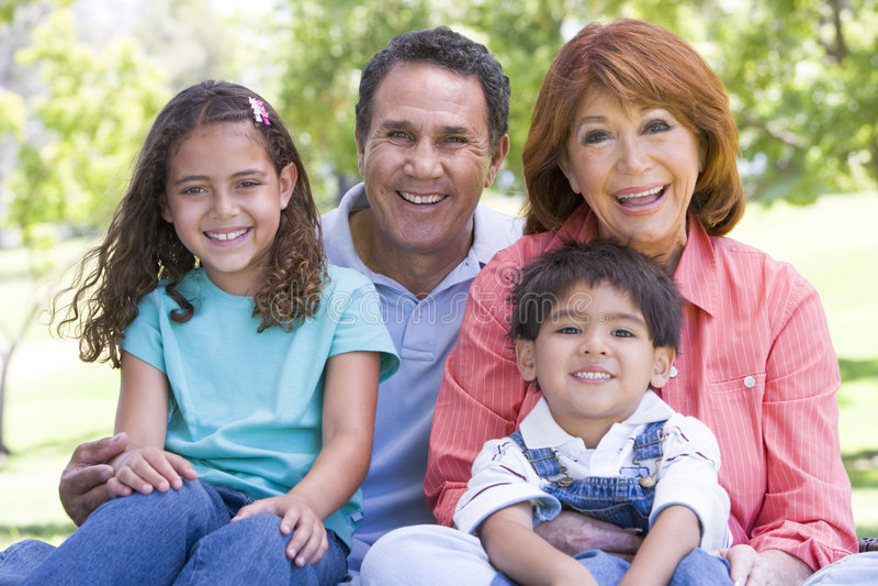 Grandparents posing with grandchildren stock photo