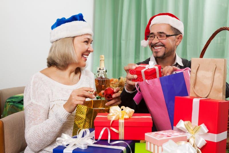 Grandparents preparing for celebrating Christmas royalty free stock photos