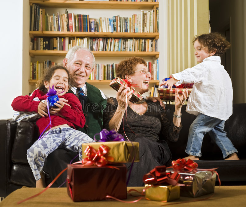 Grandparents and presents. Grandparents giving presents to grandchildren on an holiday