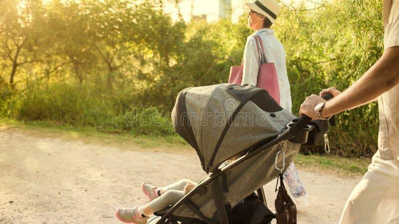 Grandparents pushing Stroller. stock images