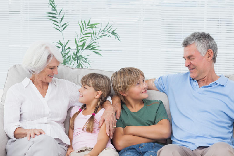 Download Grandparents Speaking With Their Grandchildren Stock Photo - Image of communication, couch: 32509554