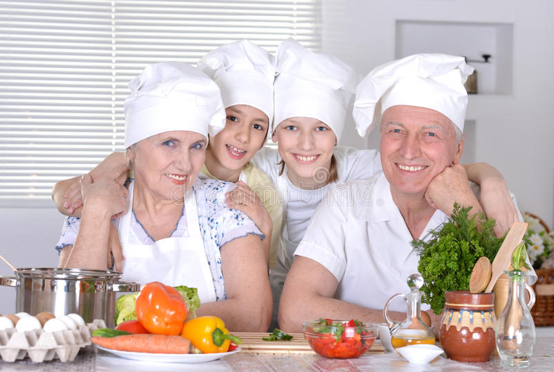 Grandparents and their grandchildren stock photography
