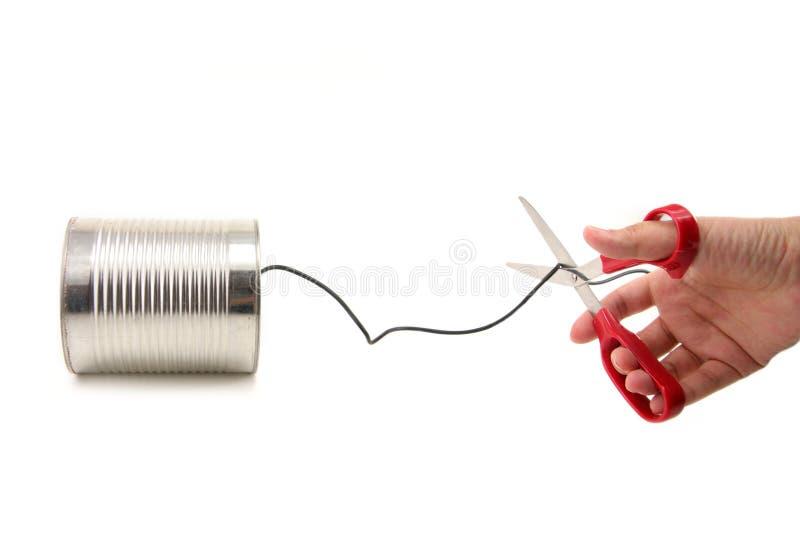 Grands ciseaux prenant soin de la ligne téléphonique images stock