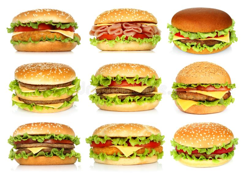 Grands hamburgers réglés sur le fond blanc image libre de droits