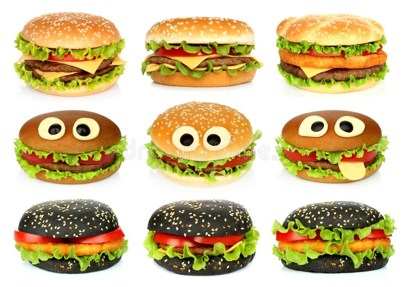 Grands hamburgers réglés sur le fond blanc photos stock