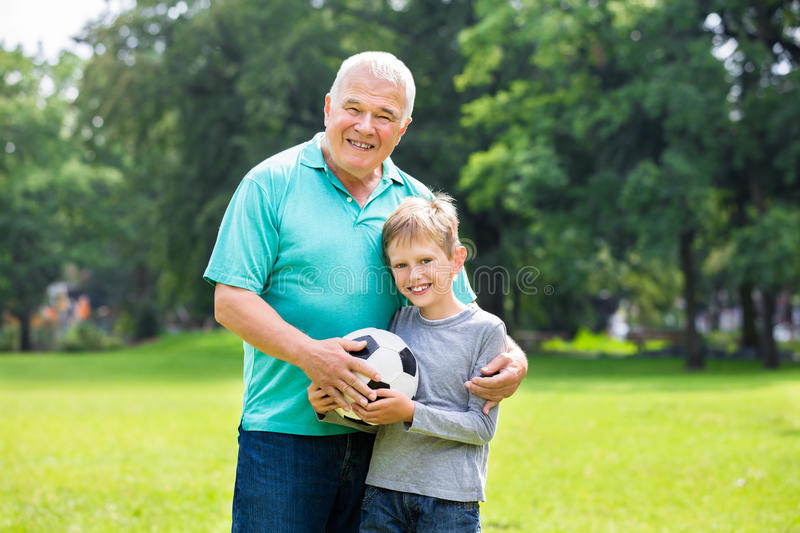 Grandson And Grandfather Playing Soccer stock photo