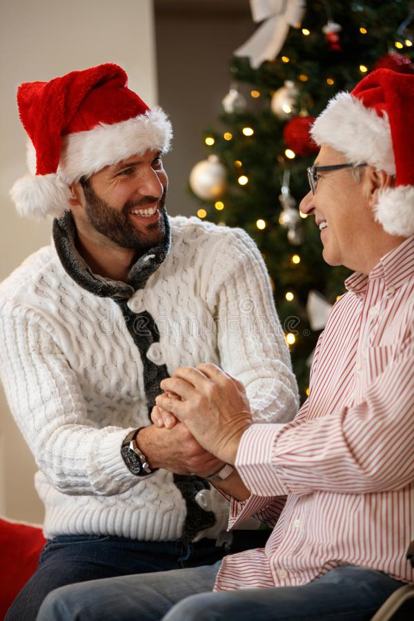 Grandson and grandfather together for Christmas royalty free stock photography