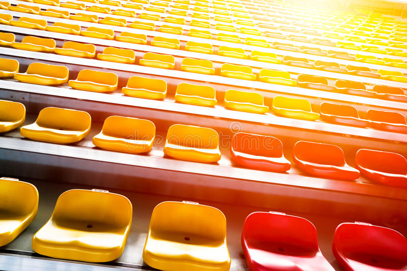Grandstand chair. Rows of stadium grandstand seats with lighting effect royalty free stock image
