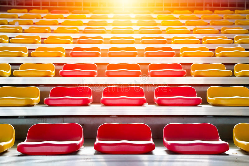 Grandstand chair. Rows of stadium grandstand seats with lighting effect royalty free stock photography