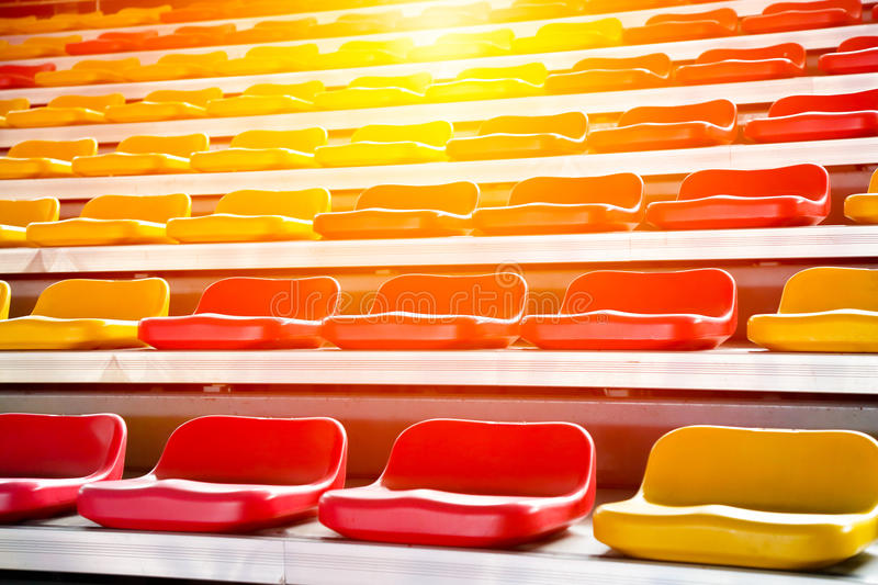 Grandstand chair. Rows of stadium grandstand seats with lighting effect royalty free stock images