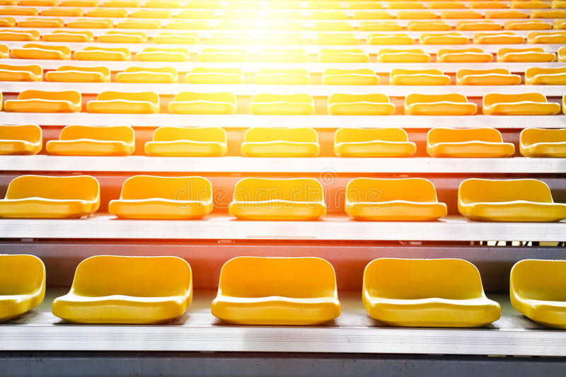 Grandstand chair. Rows of stadium grandstand seats with lighting effect stock images
