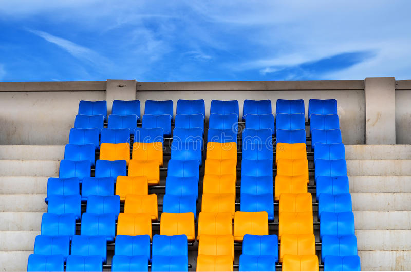 Grandstand Chairs. On blue sky background stock photography