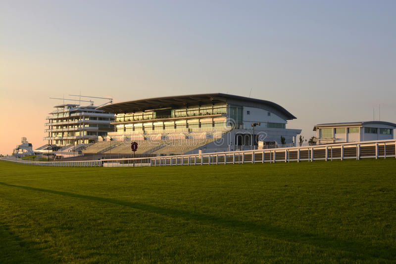 Grandstand at Epsom Racecourse. Surrey. England. Grandstand on Final straight at the horse racing course. Epsom Downs. Surrey. England. At dusk stock image