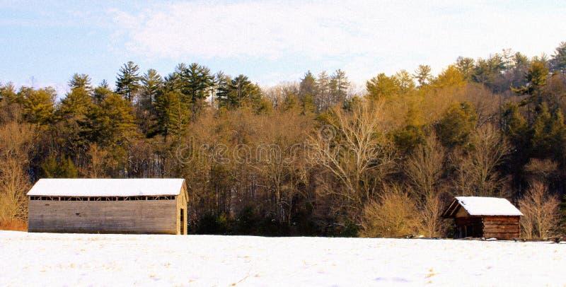 Granero y cabaña en la nieve foto de archivo