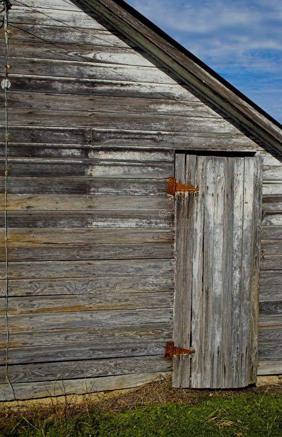 Grange et trappe latérale images stock