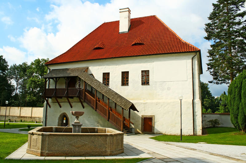 Grange house. And a fountain on the monastery court in Milevsko, Czech Republic stock photos