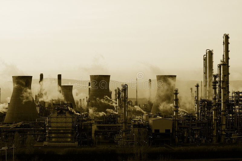Grangemouth BP Oil Refinery Mono. A view of the smoking chimney stacks of Grangemouth Oil Processing Plant/Refinery at sunset stock photo