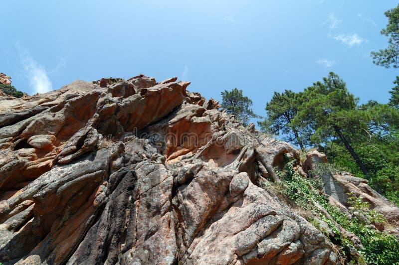 Granietrotsen in de rotsachtige inham van Piana royalty-vrije stock foto's