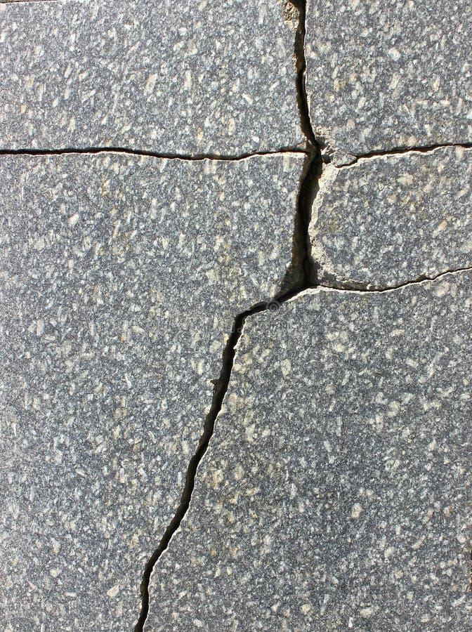 Graniettegel met een barst, zoals de textuur stock afbeelding