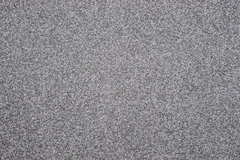 Graniettextuur - de grijze oppervlakte van de steenplak stock foto