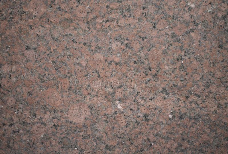 Granit en pierre de fond avec les inclusions noires, roses et brunes photo libre de droits