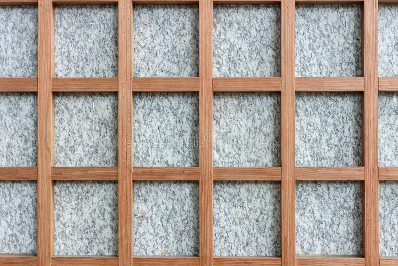 Granit- och trärambakgrund arkivfoto