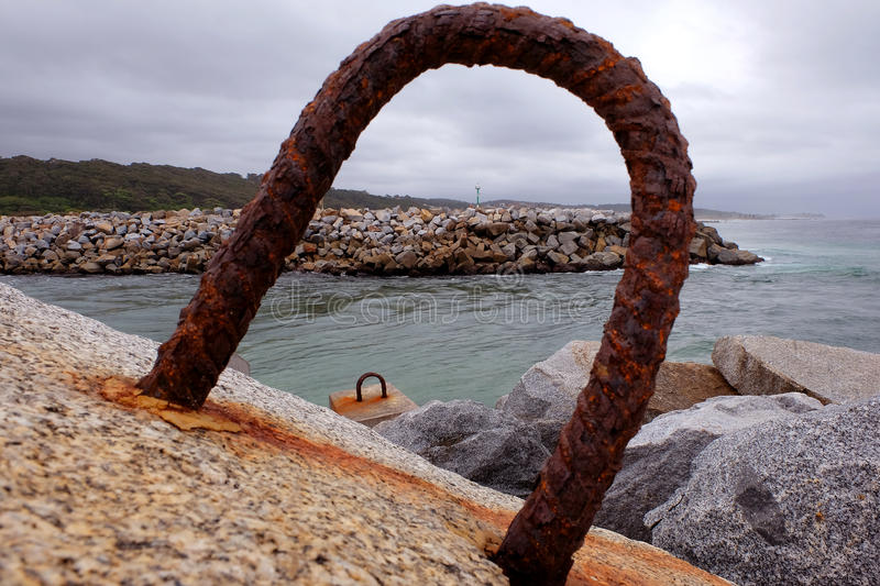Granite blocks. A ocean brealwater is constructed from granite blocks into which hoops have been fixed to allow a crane to stack them royalty free stock images