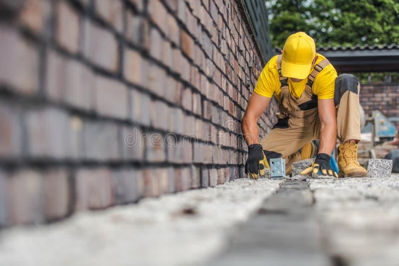 Granite Brick Paving Worker royalty free stock image