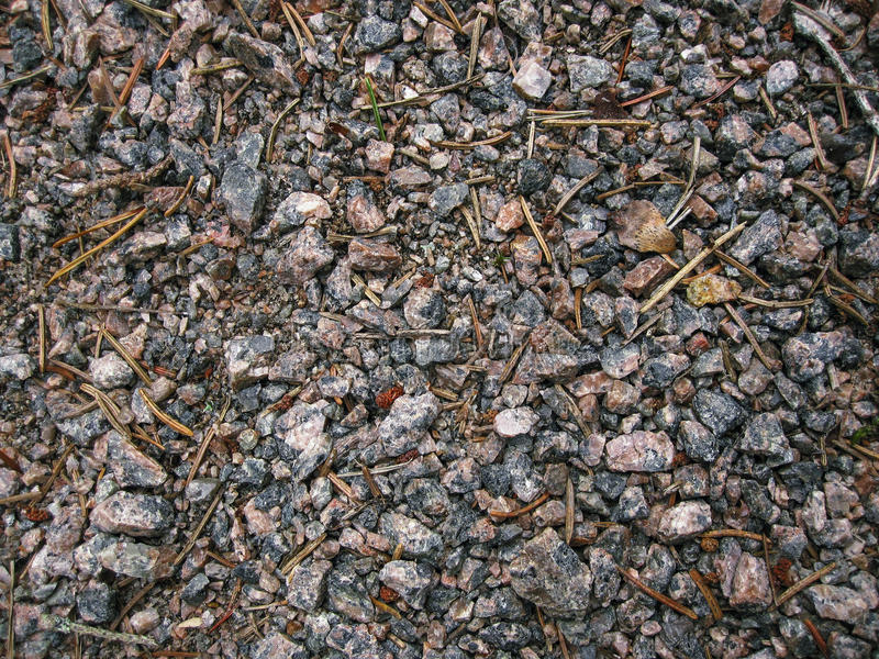 Granite chips and sprinkled crushed stone. Walkway background stock photo