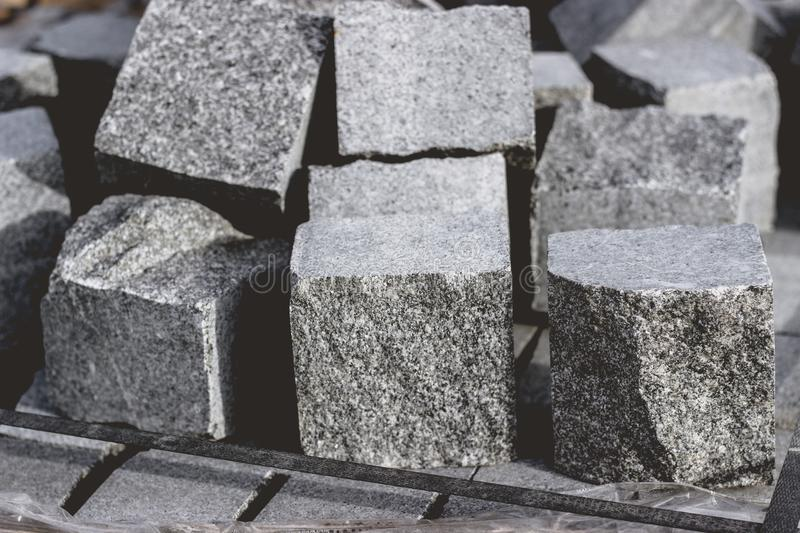 Granite cobble stone cubes on a pile for new pavement. Texture stock image