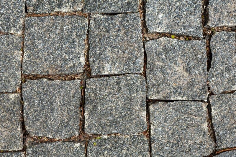 Granite cobblestoned pavement background royalty free stock photo